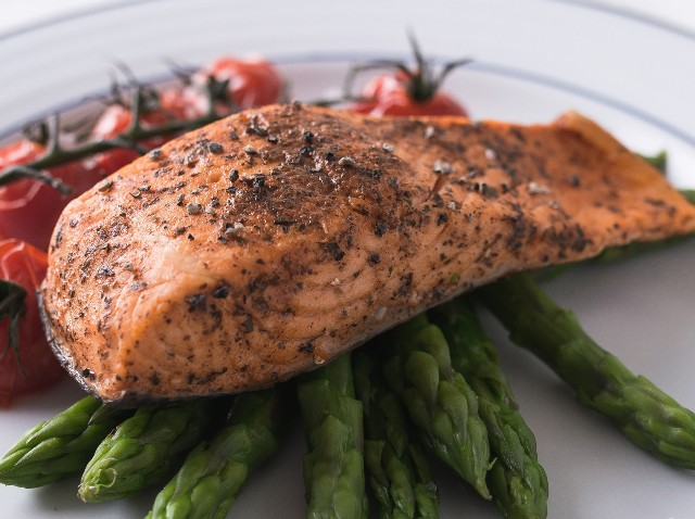 A delicious salmon fillet cooked and served with roasted vegetables