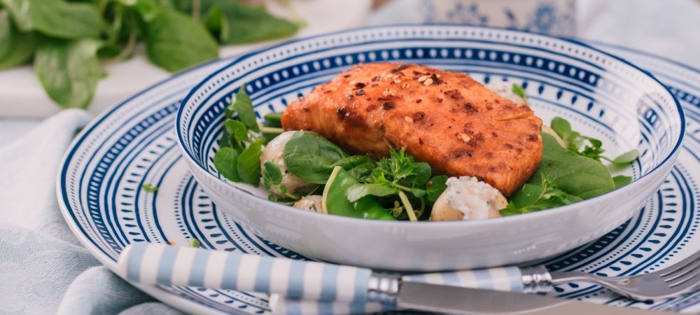 Piri Piri salmon with tzatziki and spring greens